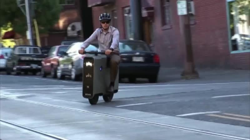 Электроскутер в форме чемодана