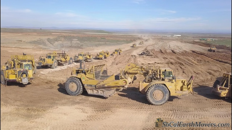 Digging new landfill cell with fleet of Caterpillar scrapers Part 1