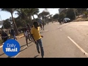 Gunfire disperses as angry opposition protests election result - Daily Mail