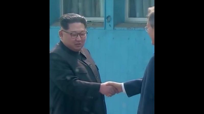 North Korean leader Kim Jong Un and South Korean President Moon Jae-in shake hands at the DMZ