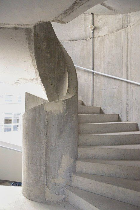 Staircase towers form corners of Uster apartment building by Herzog